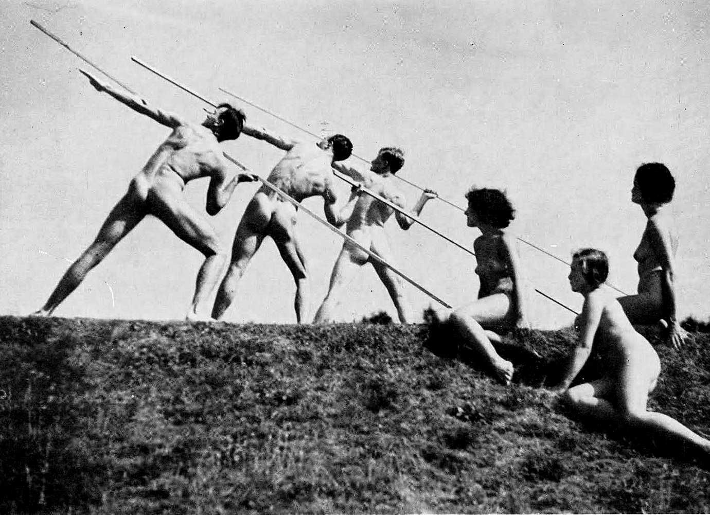 Three nude men pose to throw javelins, while three nude women look on.