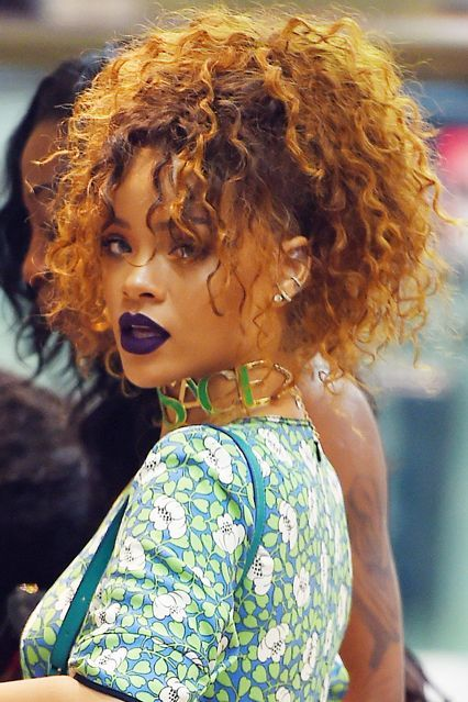 The dream of the '90s is alive in Rihanna, even if she was but a tween at the time. For a bodega run in New York, she matched her grunge-inspired dress with vampy lips and a disheveled, high ponytail (revisiting a previously worn style is so unlike her). #refinery29 http://www.refinery29.com/2016/02/103540/rihanna-beauty-looks#slide-5