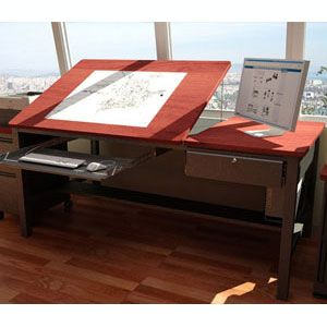 """Freedom Drafting Table 60"""" Wide. The ideal three-in-one space-saving option, this table converts from an angled surface art table to a computer table to a writing desk with a simple touch. Four size options are available to fit your needs.  The built-in grommet holes make the desk easily customizable with a space-efficient computer monitor arm and pole and additional platforms for speakers or printers. A cable management option available for electronic devices. $1109"""