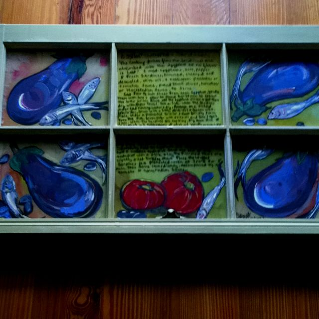 """20-31"""" size .painted on an old window by Janet Moses . Eggplants & sardines .$125.00"""