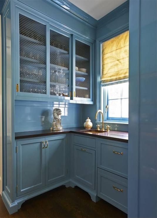 Blue butler\'s pantry features chicken wire upper cabinets and blue ...