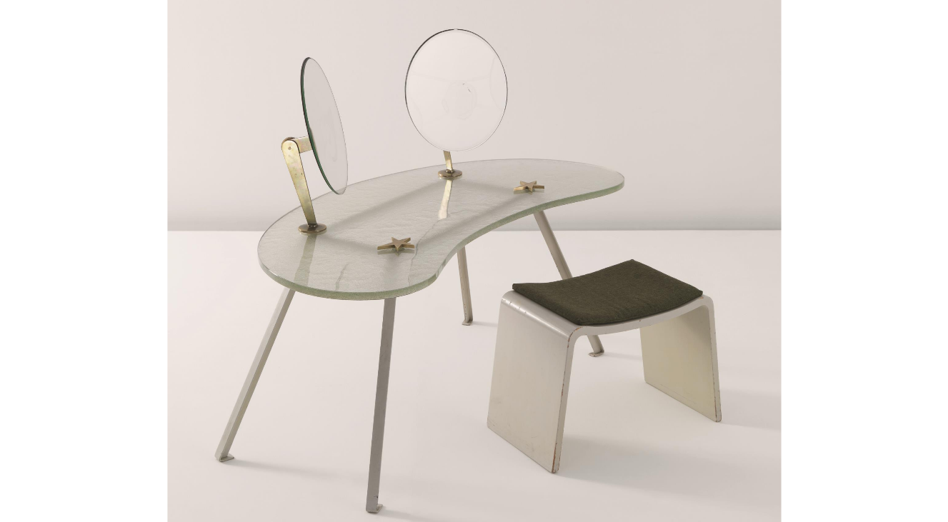 Vilhelm Lauritzen Vanity desk and stool, c. 1934 Vanity desk: shaped textured and clear glass, mirrored glass, backed with reverse painted glass, painted metal frame, bronze mounts and adjustable mirror supports; stool: painted shaped wood, fabric (2). Vanity desk: 108 x 125 x 53 cm (42 1/2 x 49 1/4 x 20 7/8 in); stool: 41 x 60 x 33 cm (16 1/8 x 23 5/8 x 12 7/8 in)