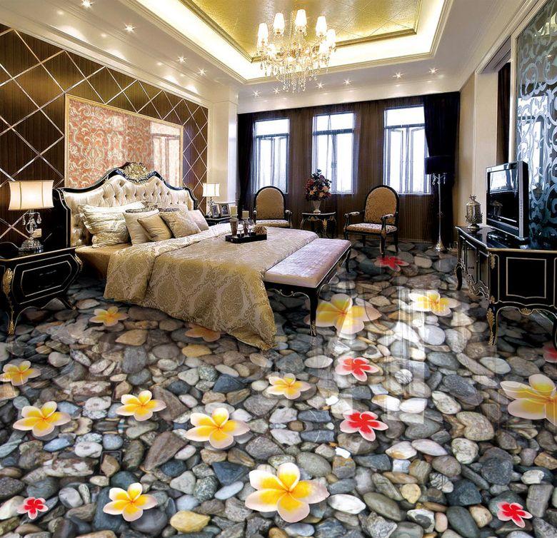 Revêtement de sol zen - Les fleurs de plumeria sur les cailloux gris