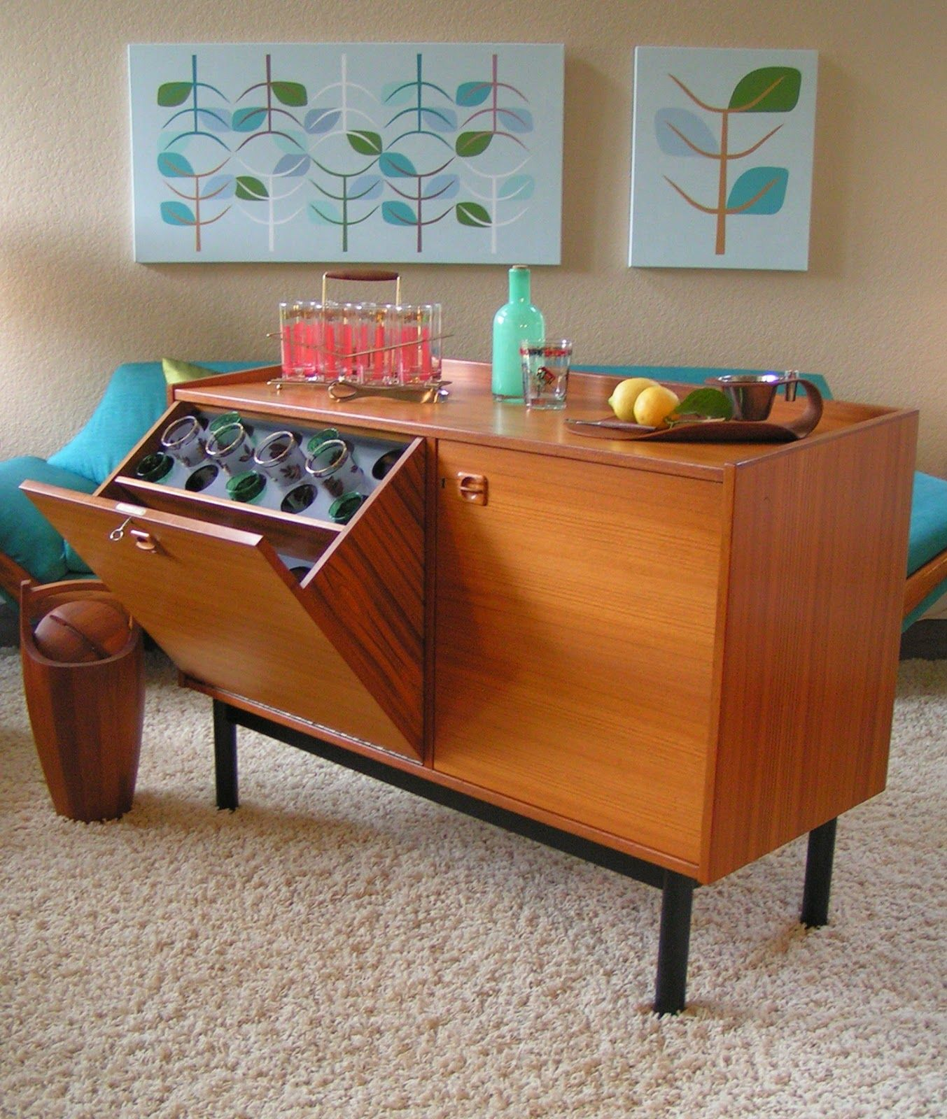 Mid century modern danish teak sideboard has a tilt open bar cabinet. Like  the design