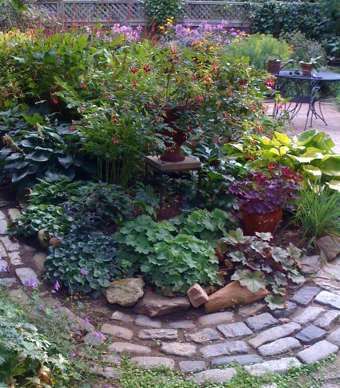 the brick path in the shade garden a few years ago.  things have changed since then