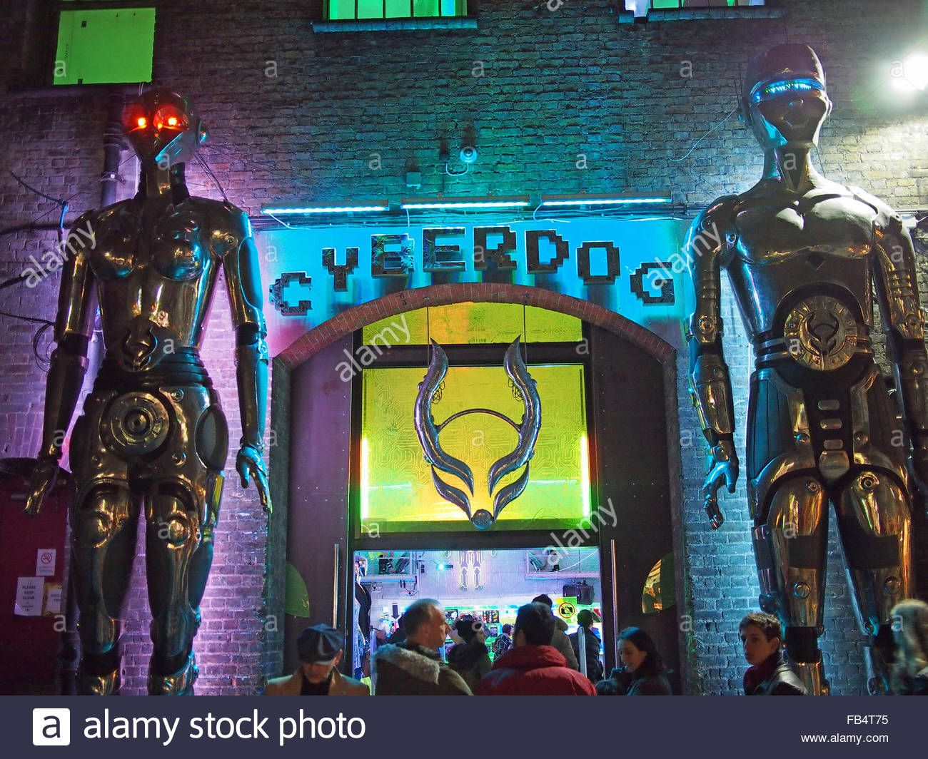 http://c8.alamy.com/comp/FB4T75/view-at-night-of-the-colourful-entrance-to-cyberdog-in-stables-market-FB4T75.jpg