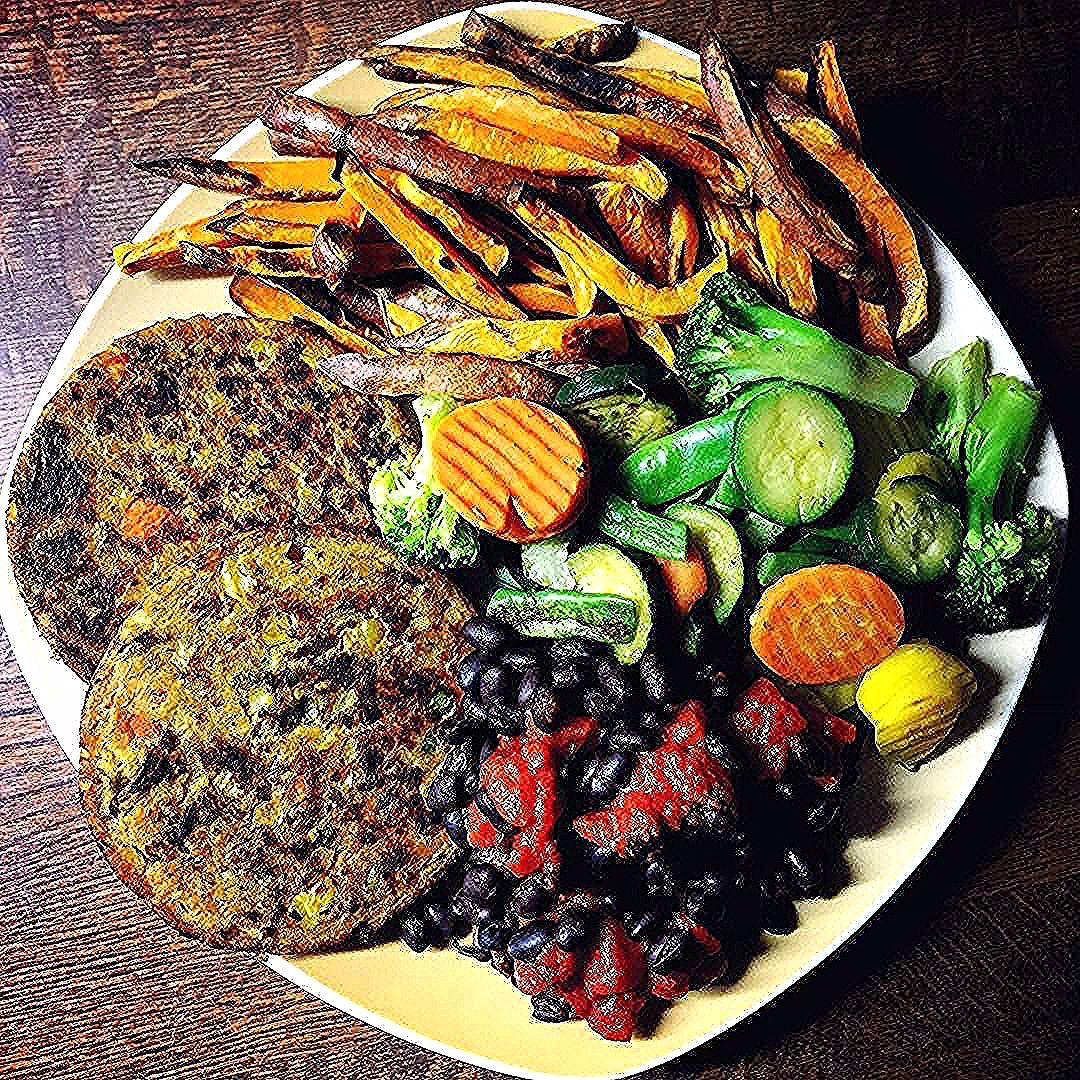 Today's a meatfree day! Enjoying a plate full of veggies   two veggie patties  oven baked sweet pota...