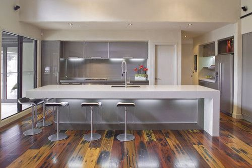 Little To No Decor Or Embellishment Is A Hallmark Of Modern Design The Floor In This Mal Corboy Des Modern Kitchen Design Kitchen Soffit Modern Kitchen Trends