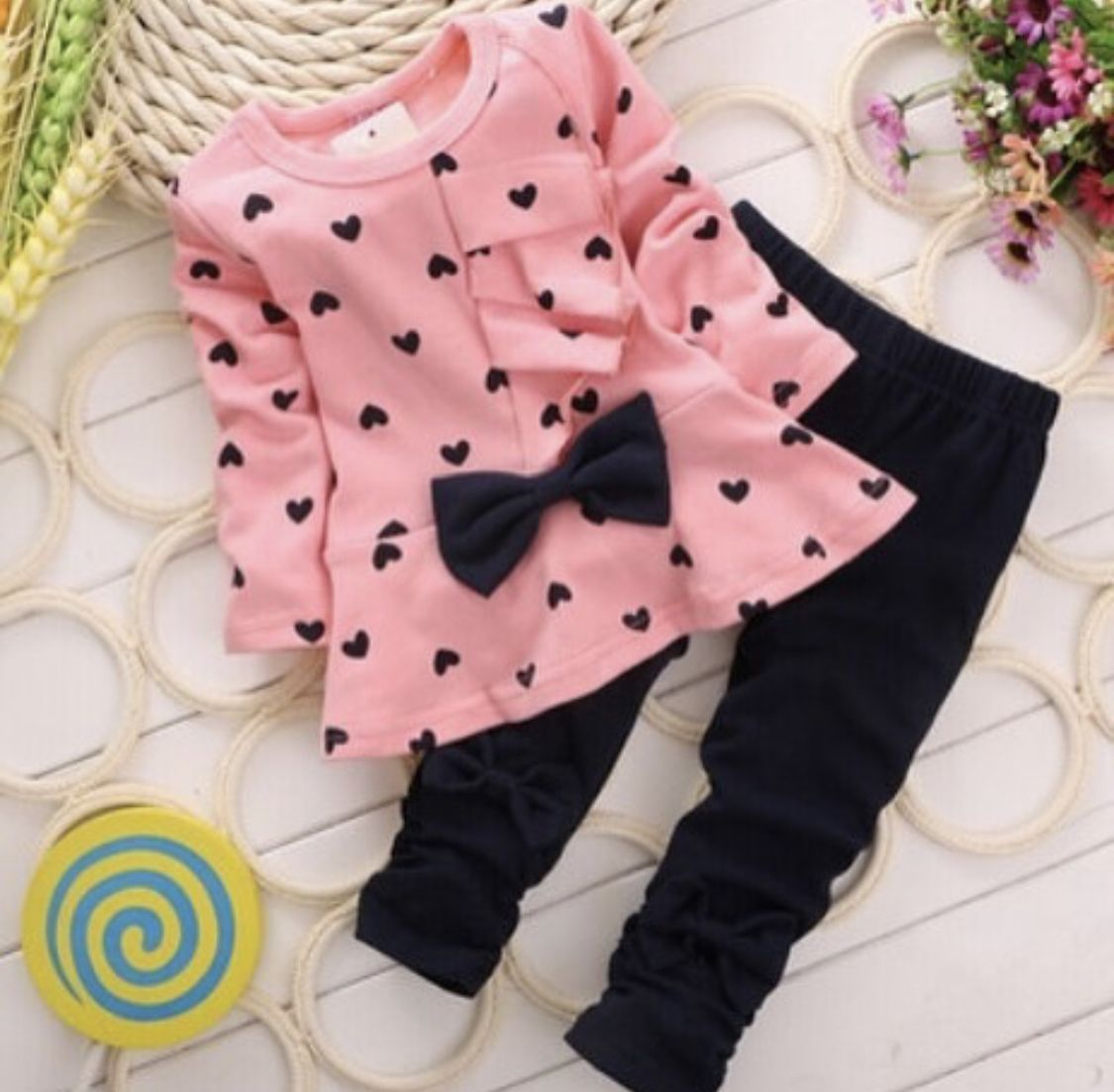 Beautiful pink and dark navy 2pc set. Top- front bow with a touch of side ruffle. Pants- both legs scrunched.  Cotton & Polyester   #babygirl #frontbow #babyapparel #onlineshopping #scrunchedleggings #2pcset #littlegirl #childrensboutique #onlineboutique #shoppingonline #shopnow #childrensonlineboutique #onlinestore #childrensonlinestore #shoppingchildren