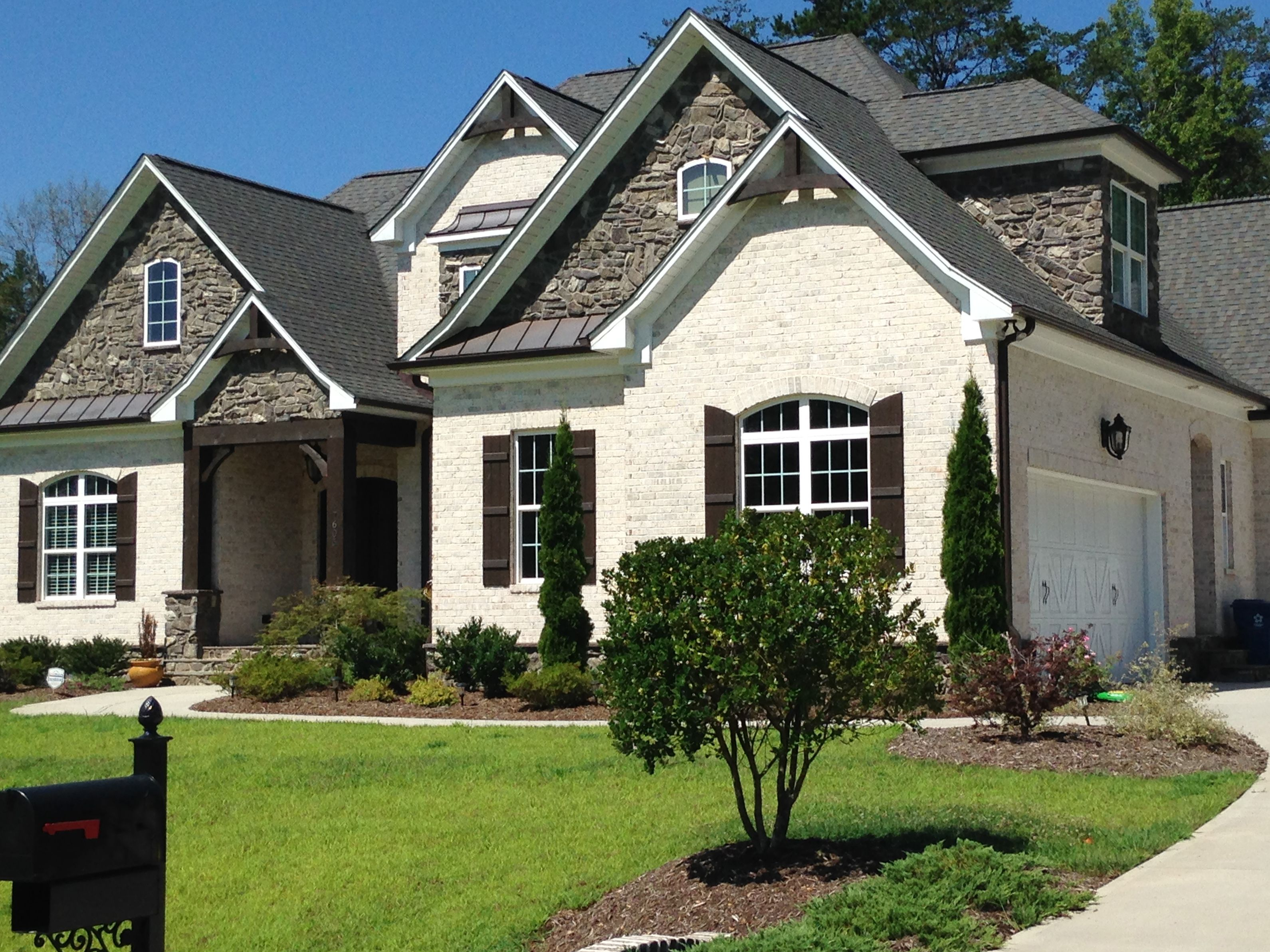 White brick options chesapeake pearl here with gray roof for Roof accents