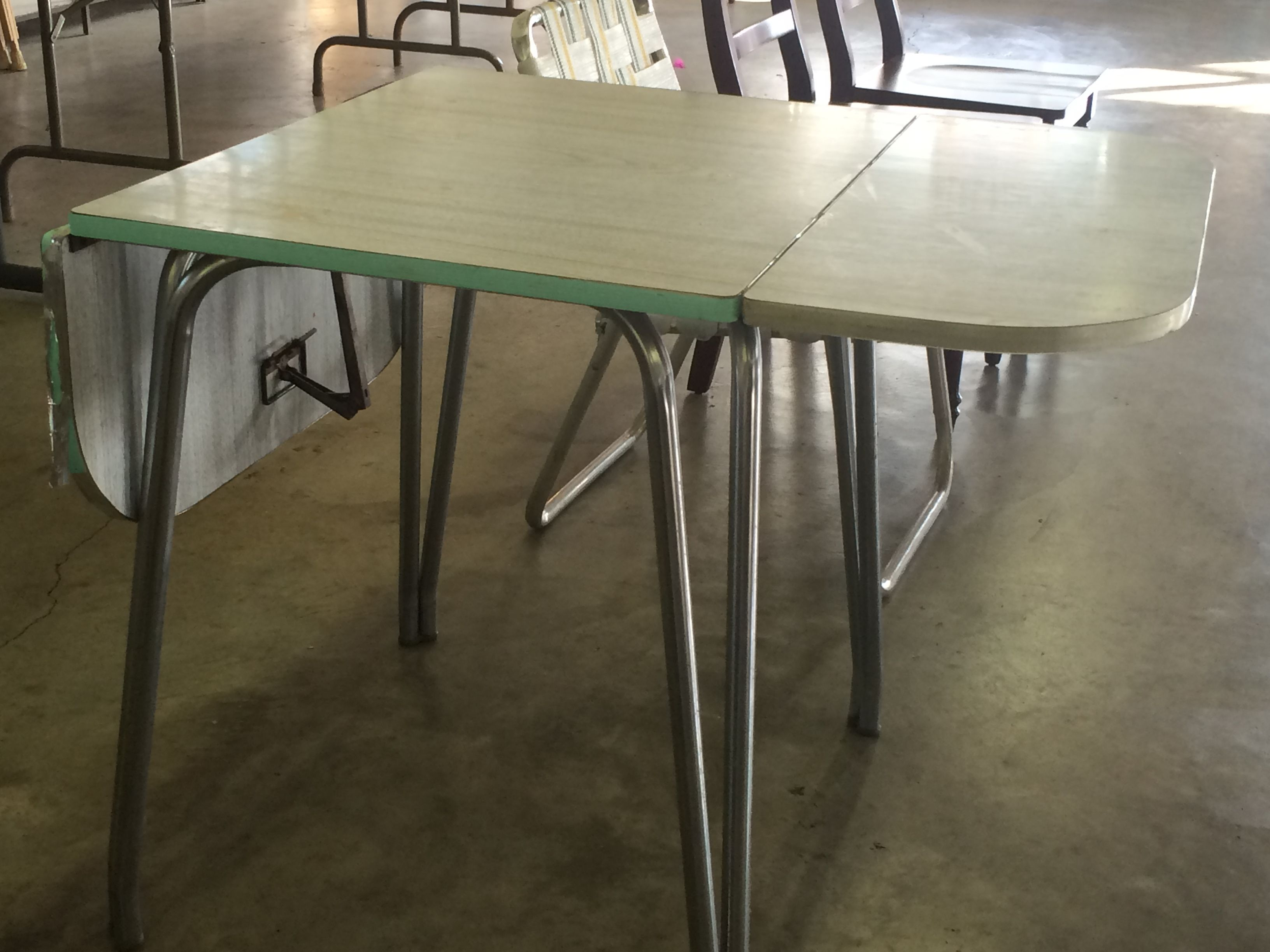 Mid century table with fold down sides