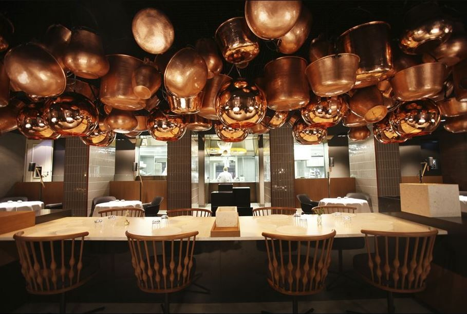 modern restaurant interior design simple lines natural materials warm lights statement decor made