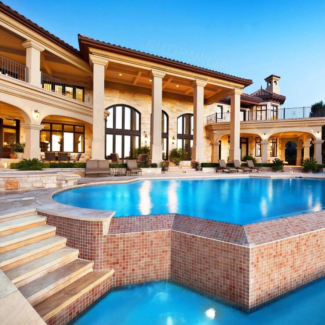 massive stone mansion with an infinity pool that flows into another infinity pool 7829 escala