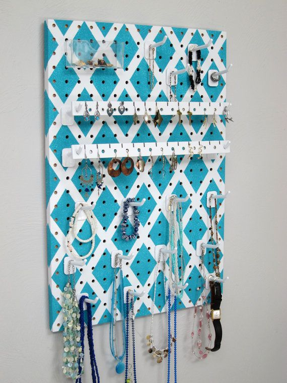 This colorful turqoise jewelry organizer hangs on your wall or