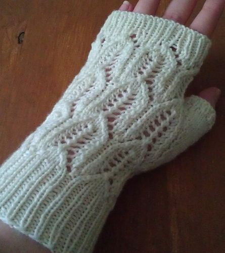 These mitts are done in a lace pattern, and uses about 50 grams of a fingering weight yarn.