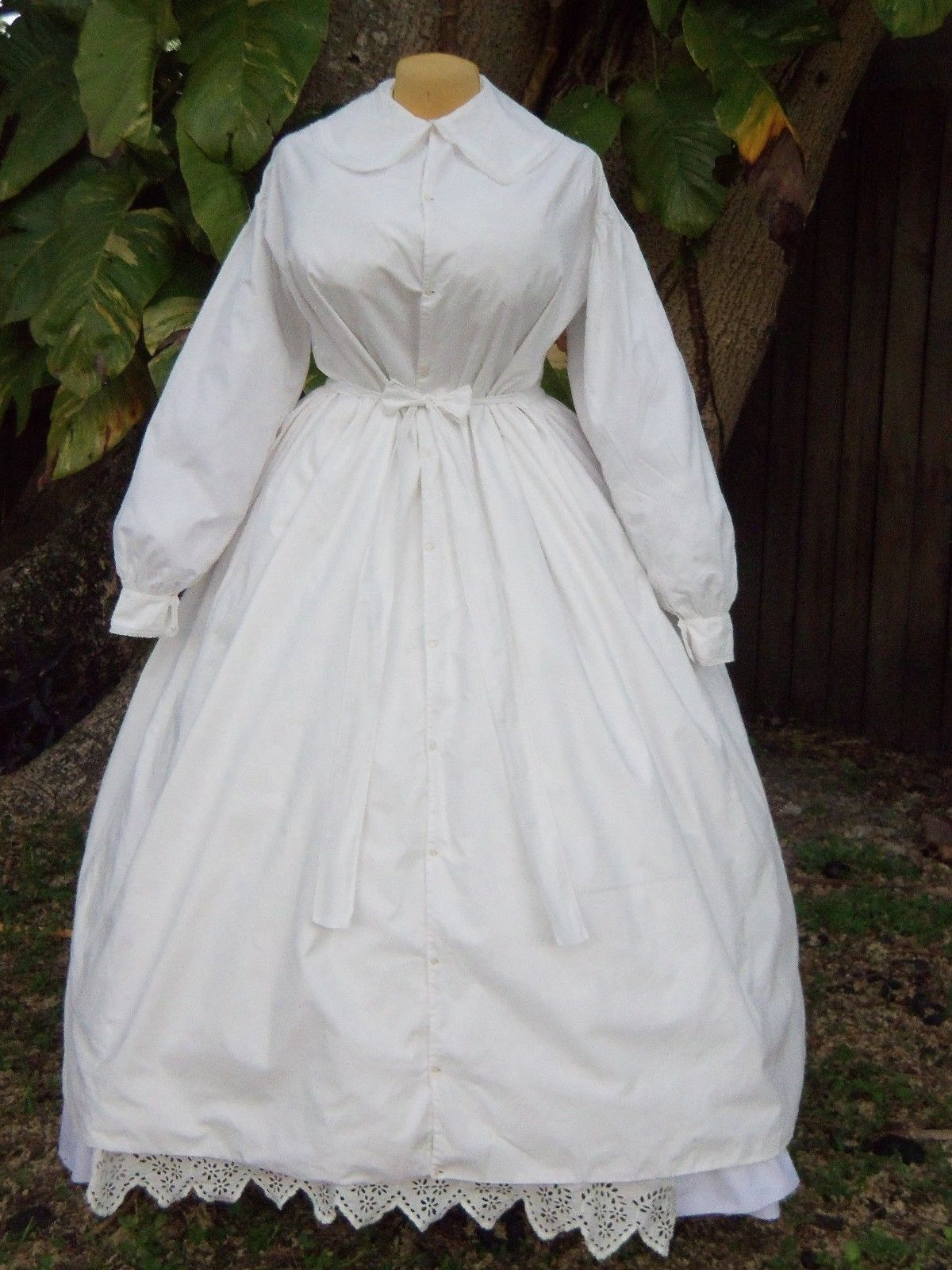 """(Maternity) Wrapper C1860 Lg Sz   eBay Interior drawstring holds it closely to the figure at back, but could be dispensed with eventually & lg amt of fabric at front would accommodate the figure. Crisp white cotton & decorated w/tiny embroidery. Self-lined in front panels, back part of skirt unlined- only faced at hem. Fastens w/tiny pearl buttons all the way to hem, can be left open from waist to show petticoat.  Note: petticoat shown NOT included.  43"""" B, 31"""" W. Skirt 36"""" L front/39.5"""" L…"""