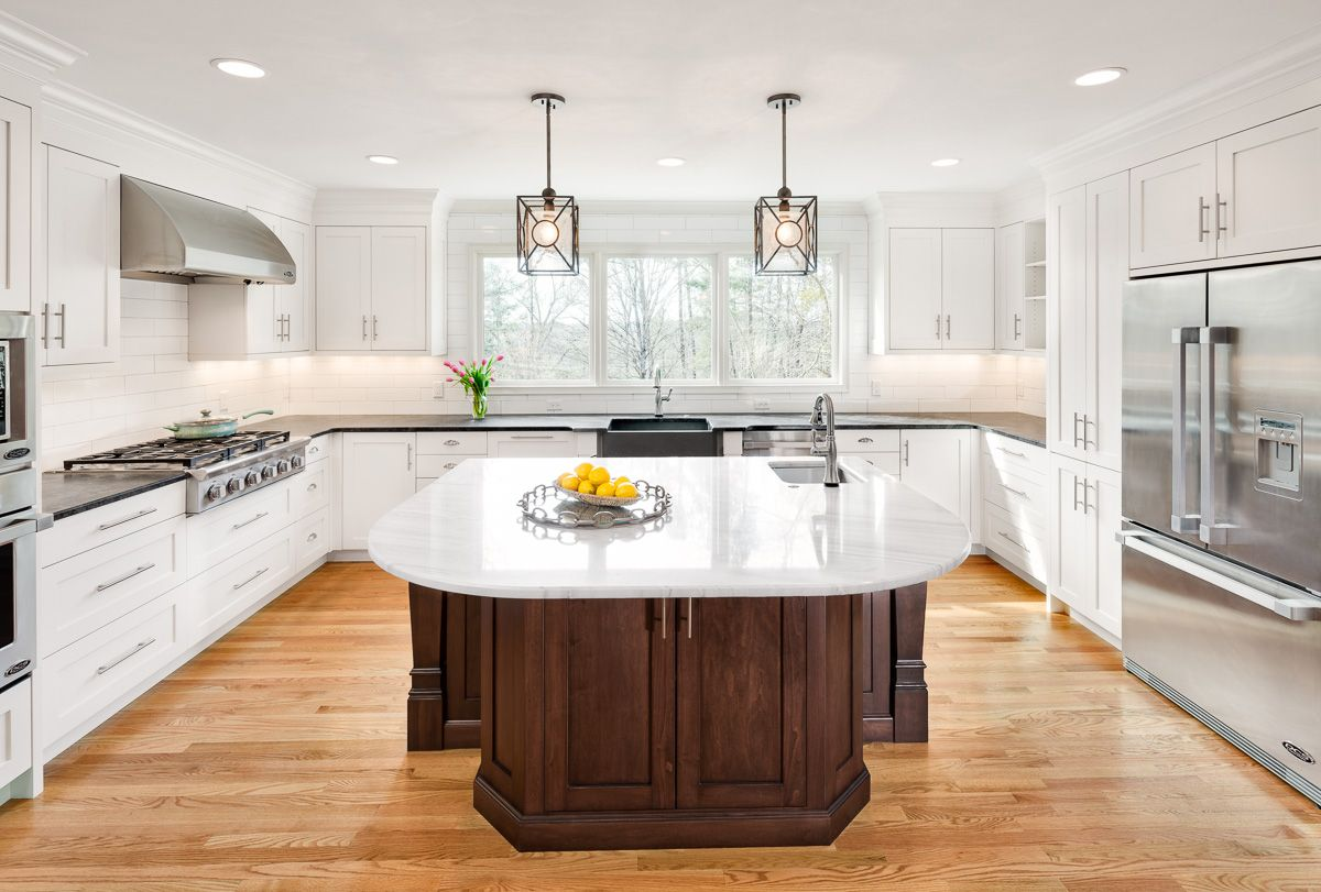 This modern kitchen features a custom built concrete sink, honed ...
