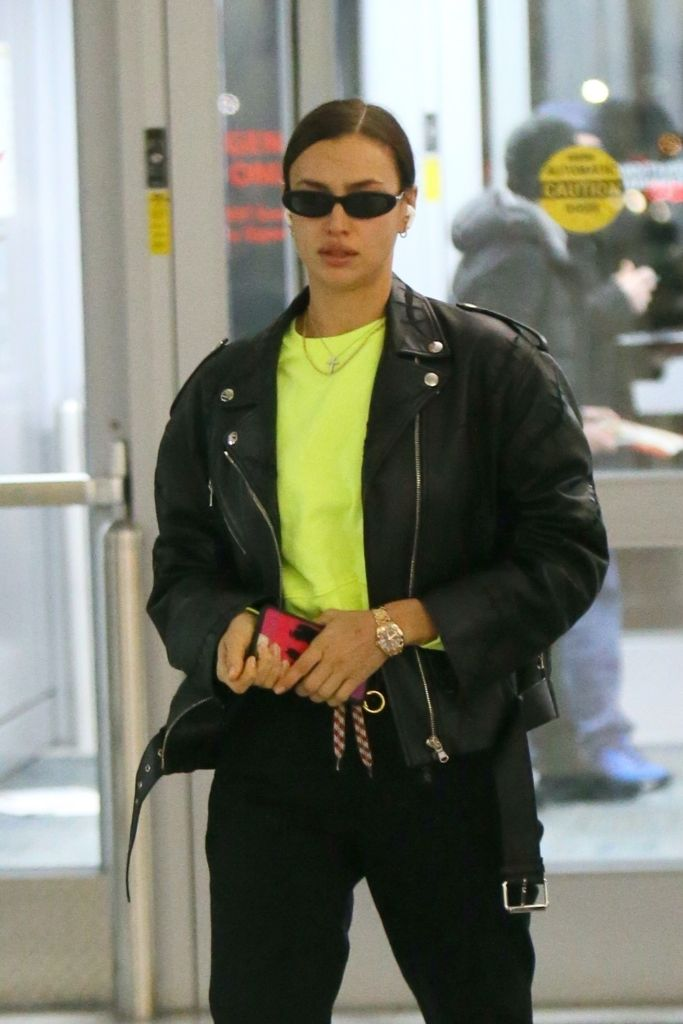 Irina Shayk in Green T-Shirt With Jacket and Jeans During Arrive at JFK Airport in New York 02-16-2020... –  #IrinaShayk #celeb #celebrity #awesome #nice #fashion #girl #london #dish #breakfast #photo #nyc #ny #boot #hair #nail #dress #red #pink