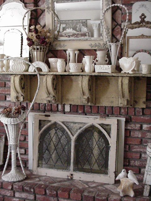 Amazing old arched and leaded glass window used as a - Ideas to cover fireplace opening ...