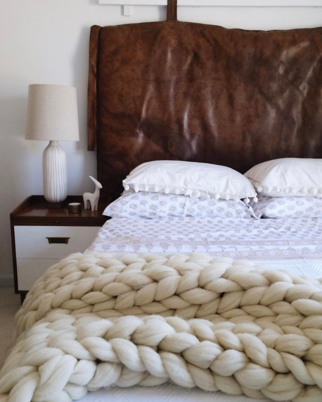 Vintage brown leather gym mat hung as a headboard in bedroom ...