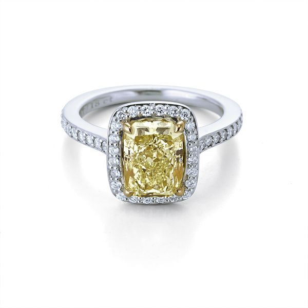 2 Carat vvs2 fancy yellow diamond Pavé set halo set in platinum