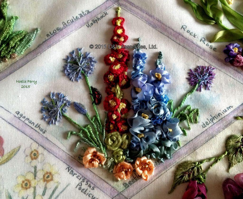 Agapanthus, Beetle Daisey, Delphinium, Hollyhock flowers