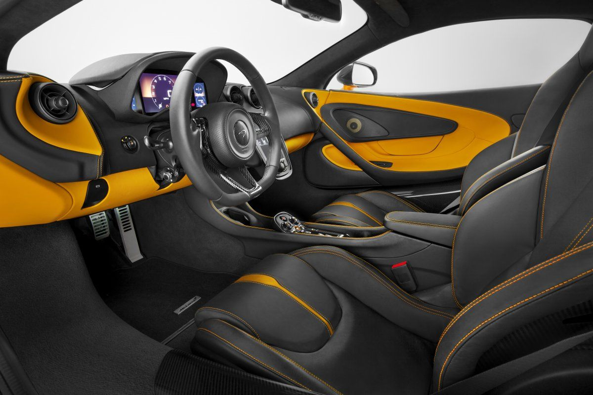 The 570's interior is traditional McLaren: race ready technology with a hint of English luxury. If orange leather is a bit over-the-top ...