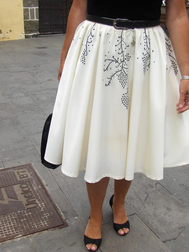 I like the idea of painting onto a circle skirt for this