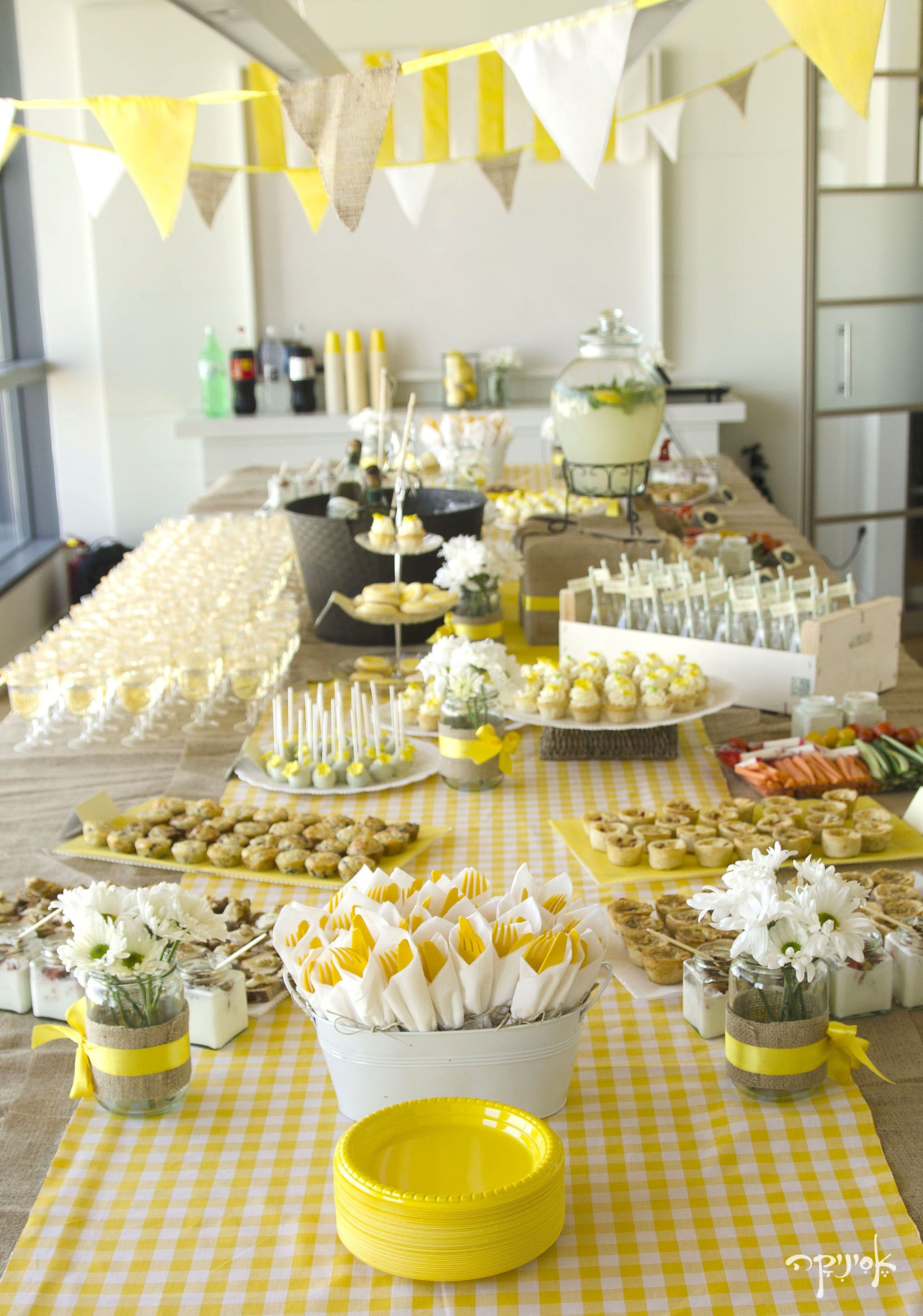 Festive Yellow Spread With Bows Ribbons Bunting And White Flowers