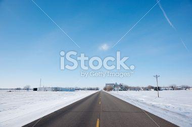 Two Lane Highway Passing through Remote Rural Town Royalty Free Stock Photo