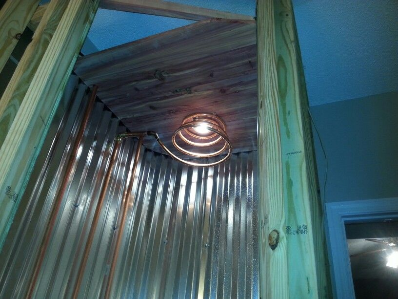 Corrugated Metal Shower With Exposed Copper And Cedar