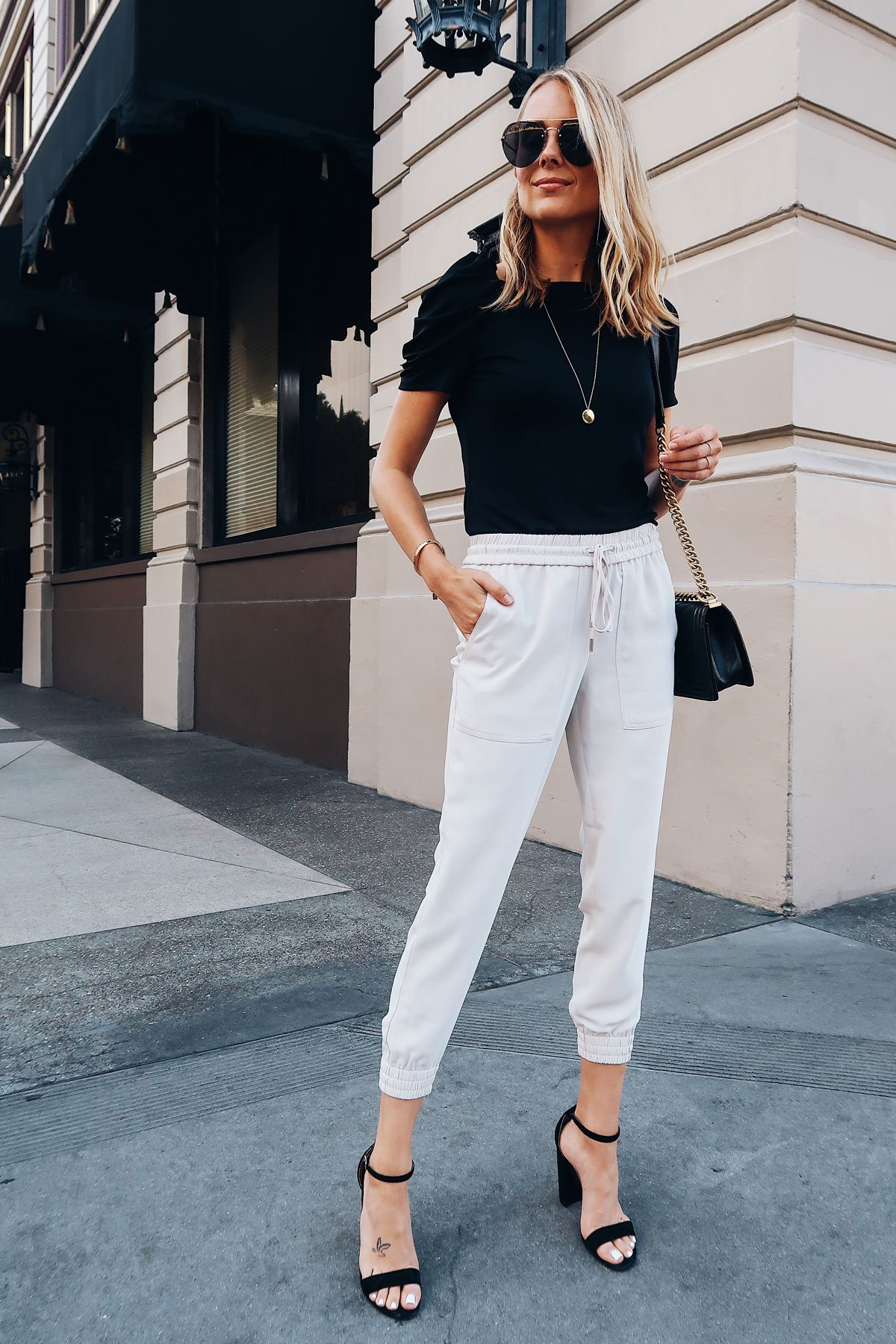 0c6d03b0d1b84 Blonde Woman Wearing Ann Taylor Black Ruched Sleeve Top Ivory Jogger Pants  Black Ankle Strap Heeled Sandals Aviator Sunglasses Fashion Jackson San  Diego ...
