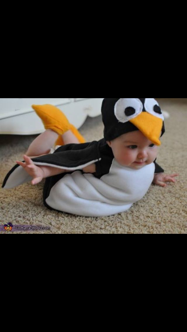 Couldn't be more adorable, baby and penguin-cuteness overload!