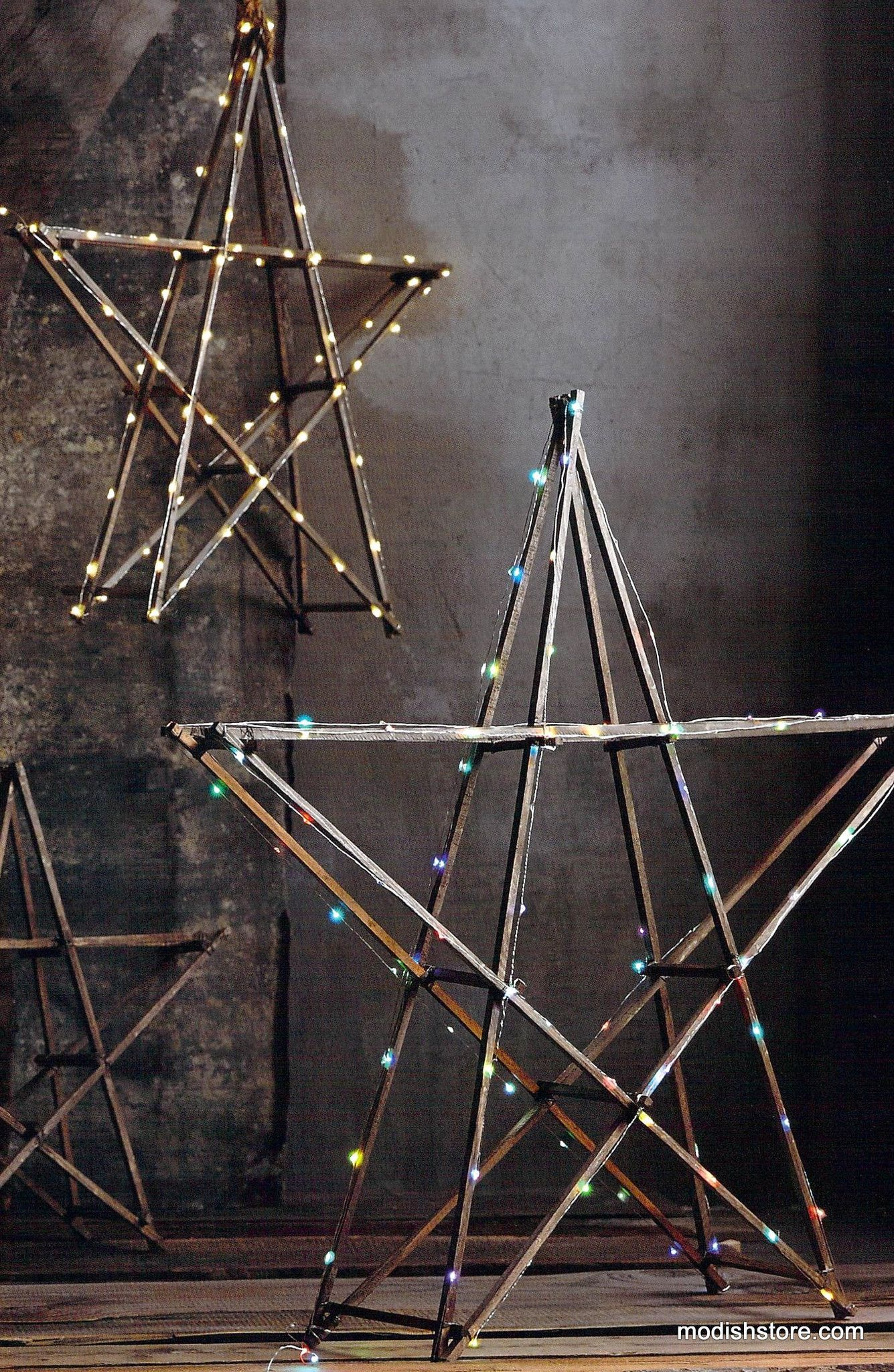 Bountifully-sized stars are simply constructed from rough-hewn wood and are the perfect platform for displaying holiday lights. Lights are sold separately below. Use 100-light strand for small and med