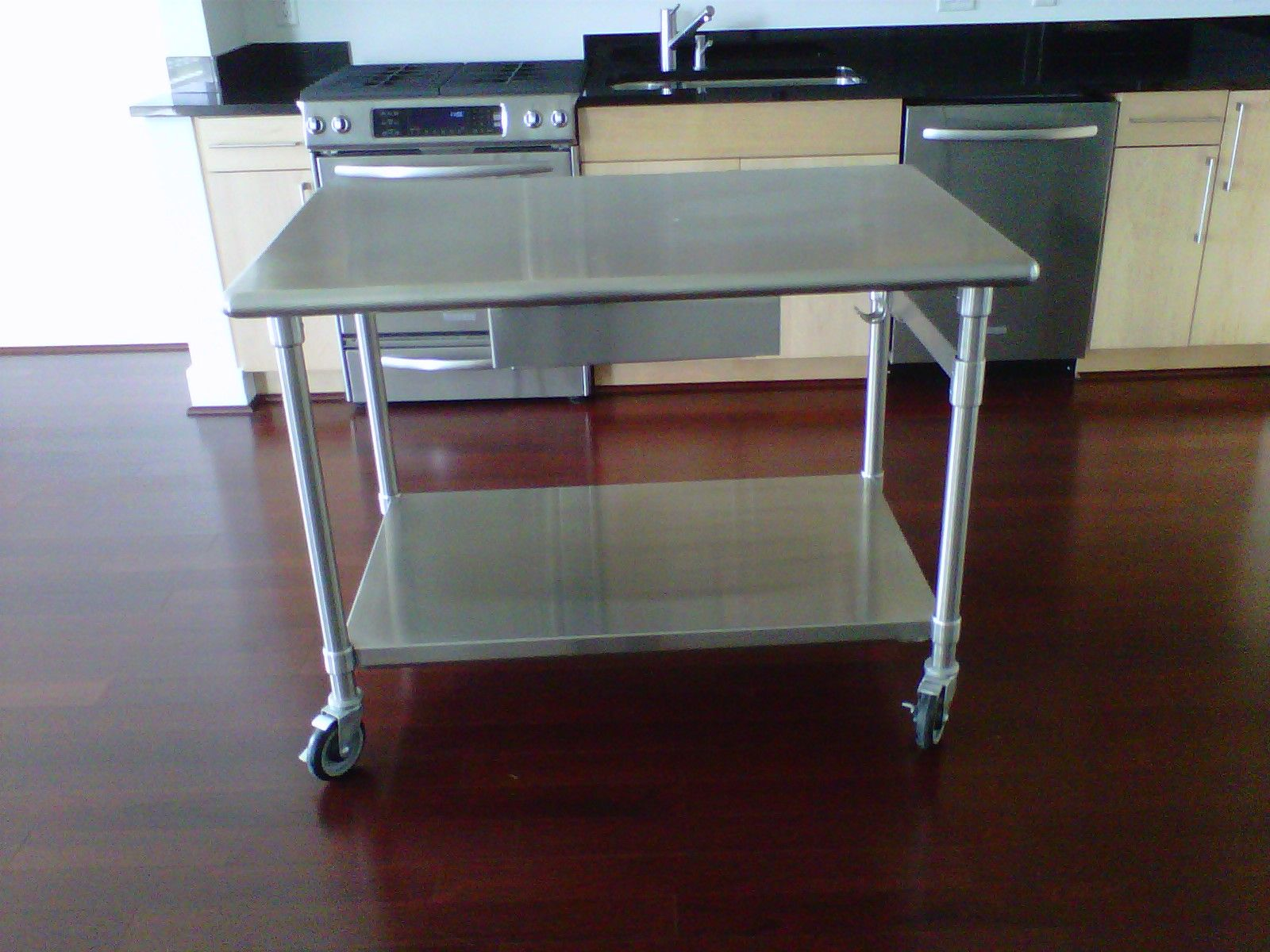 Stainless Steel Kitchen Table Which Can Also Be Used As A Kitchen Island In  The Kitchen