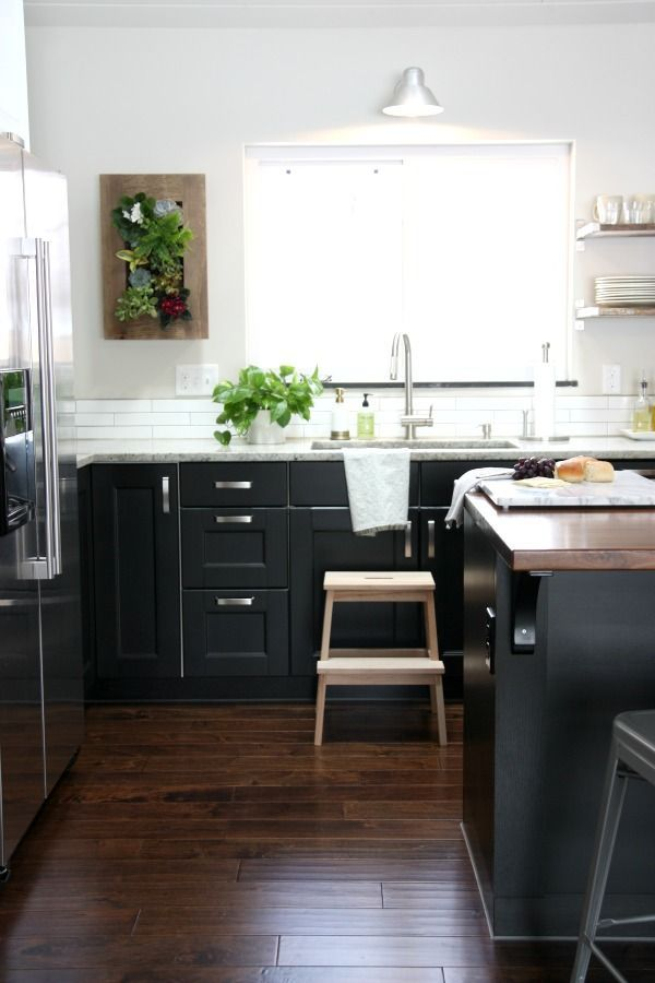 Kitchen Features Black Ikea Cabinets Ramsjo Accented With Varde Handles Paired Kashmir White Granite Countertops And