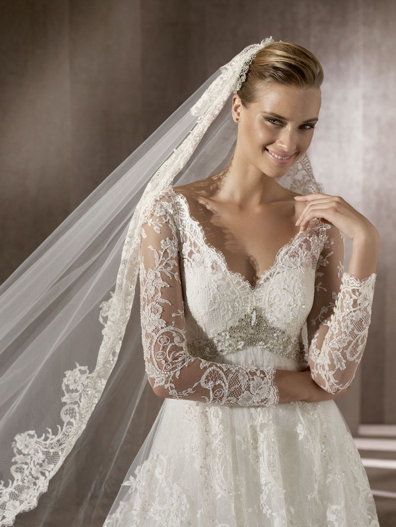 Romantic lace wedding dress with sheer sleeves traditional bridal