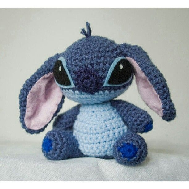 Stitch...........love him, he's sooo cute! Next time I'm going to Disney, I wanna buy everything Stitch related! Better start saving up
