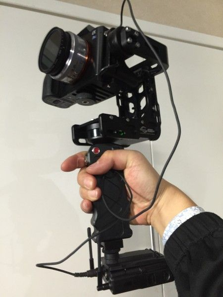 Nebula 4000 Lite. A Sony UWP-D wireless mic attached via a cold shoe to the base of the Nebula handgrip