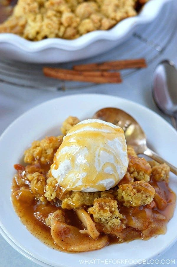 """This gluten free caramel apple crisp is the perfect dessert for that chilly fall weather. It's full of warm spices and caramel. Make sure to serve it with some vanilla ice cream and an extra drizzle of caramel sauce.  Once upon a time, I was obsessed with Ina Garten. I loved all her recipes, I have all her cookbooks, and I?ve watched just about every single one of her Food Network episodes. I feel like Ina is the millennials equivalent to Julia Child. Who?s with me on that"""" One of my"""