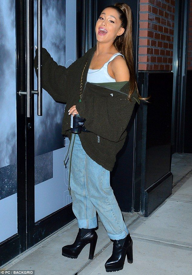 Ariana Grande looks classic while visiting her Sweetener Experience