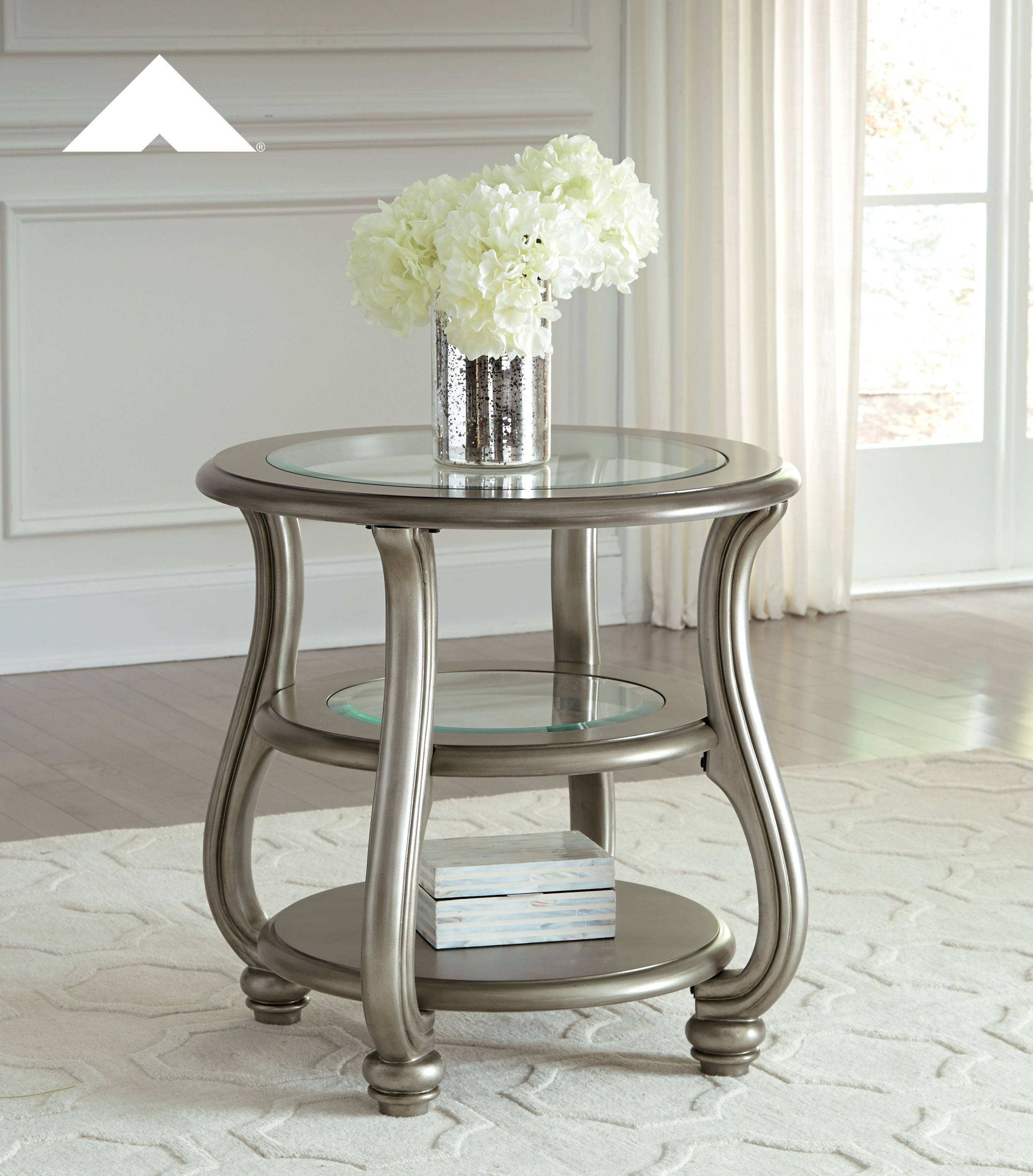 Coralayne metal silver finish hollywood inspired round end table by ashley furniture ashleyfurniture homedecor livingroom table tables
