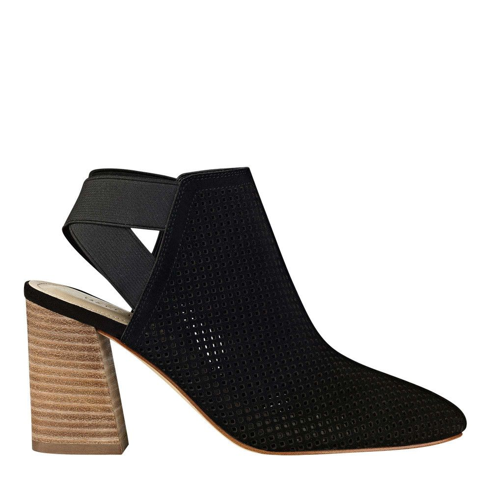 The Relay is a backless suede bootie detailed with perforation, an elastic ankle strap and stacked wooden heel.