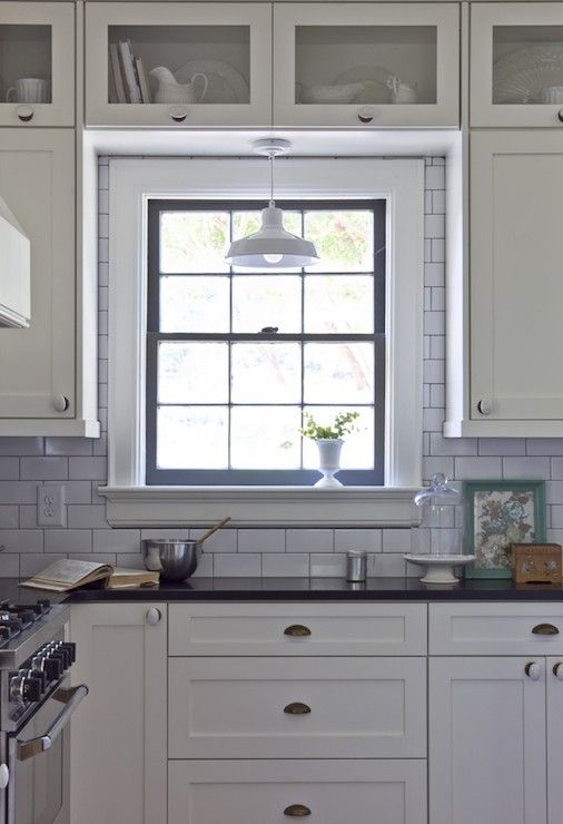 Black and white cottage kitchen with white shaker cabinets ...