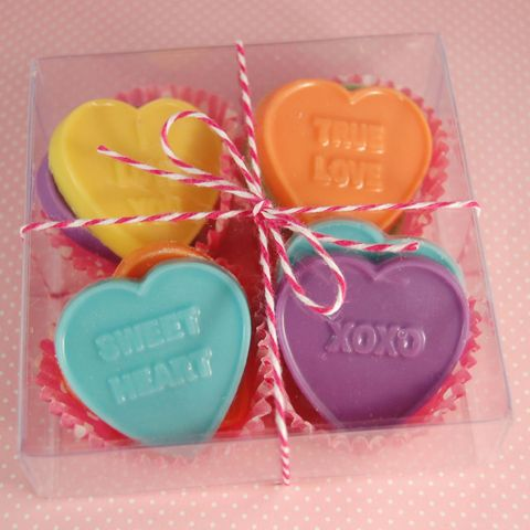 Adorable, don't you think?  Classic conversation hearts, molded from chocolate, nestled in mini baking cups.  They look so happy!