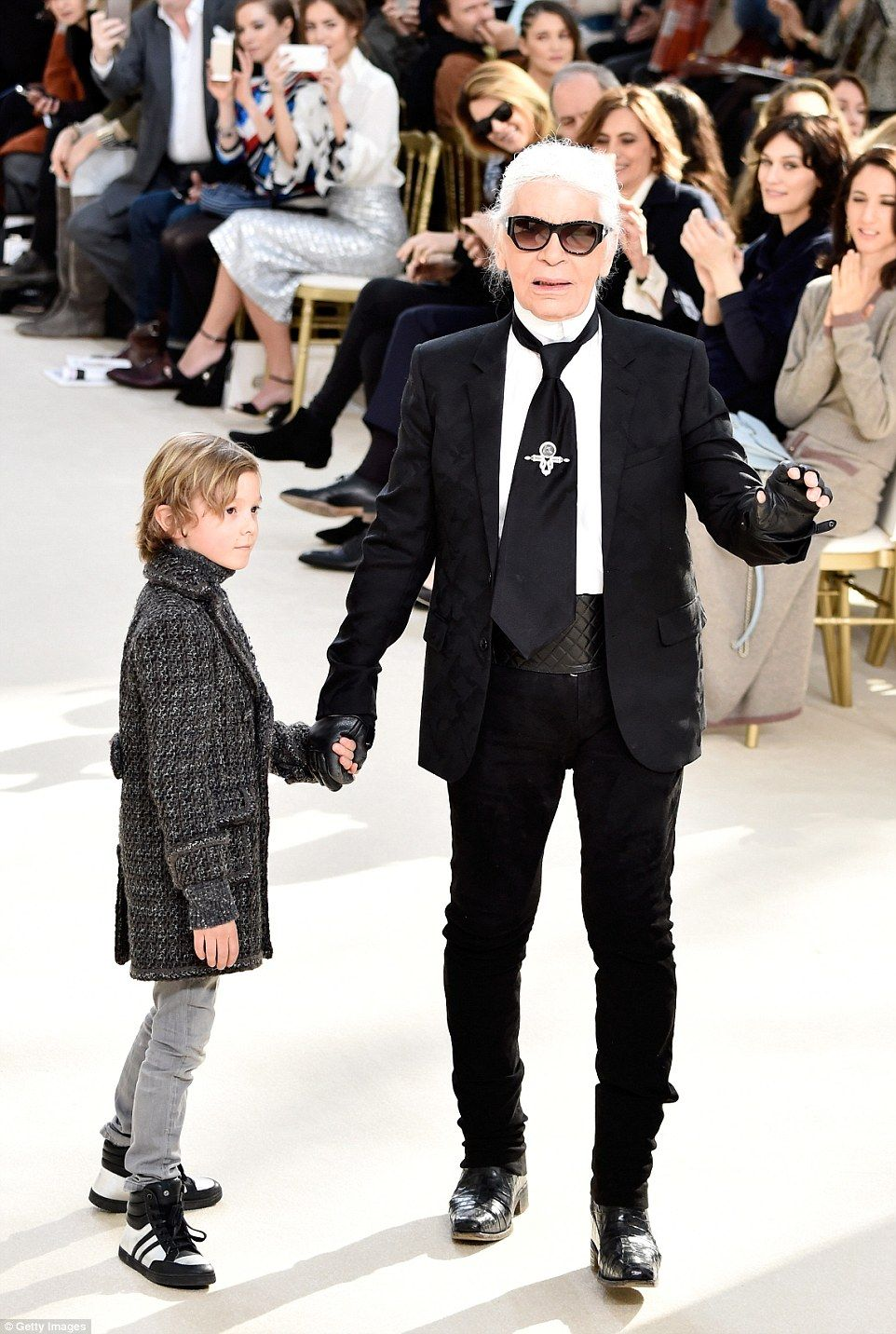 Nearest and dearest: After sending his favourite models down the runway, Karl Lagerfeld ap...
