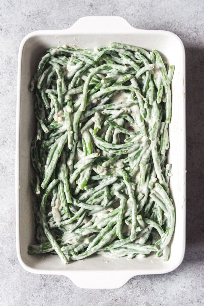 An image of make-ahead green bean casserole before adding the breadcrumbs and fried onions on top. #friendsgivingfood