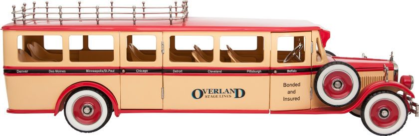 SCALE MODEL OVERLAND TOUR BUS BY RETRO 1-2-3 Length: 28-1/2 inches (72.4 cm) Steel construction 1.10 scale model of a vintage Overland Stage Lines mid-western tour bus with many working elements.