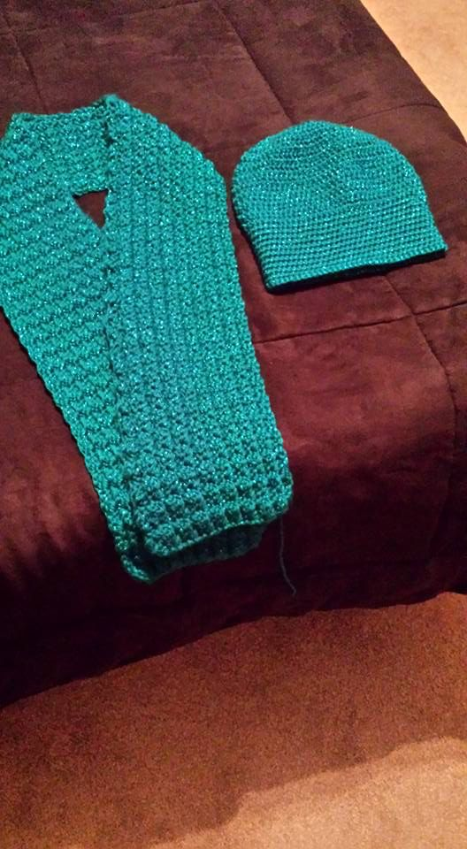 This scarf and slouchy hat was created for my daughter's friend. It was created with Caron Simply Soft Party yarn in Turquoise. It has metallic strands throughout that are similar to the yarn color. It gives it a nice sparkle.