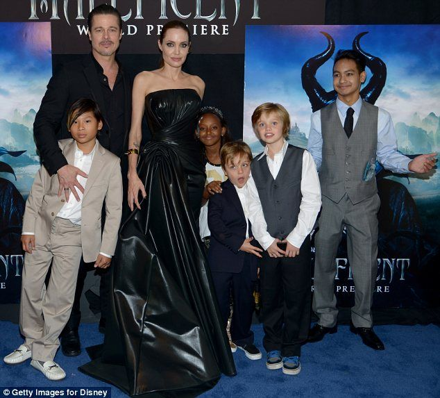 5/28/14.  A family affair: Angelina, wearing Versace, was joined by Brad Pitt and five of their six children, (L-R) Pax, Zahara, Knox, Shiloh and Maddox